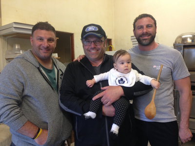 Donny, James and David posing with little Giulia, the 5th generation of bakers
